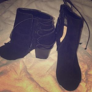 Black lace up high heels.